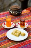 Orange and apple Turkish tea with baklawa Royalty Free Stock Images