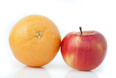 Orange and apple. On a white background Royalty Free Stock Photos
