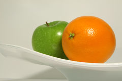 An orange and an apple Stock Photo