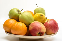 Orange, apples and banana on the wooden plate Stock Photos