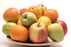 Orange, apples and banana on the wooden plate stock image