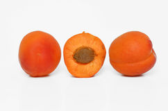 Orange apricots on white Stock Photos