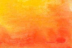 Orange Aquarell gemalte Hintergrundbeschaffenheit Stockfotografie