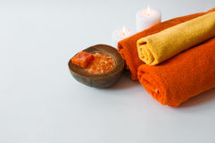 Orange aromatherapy - bath salt, soap, towels and candles Stock Photo