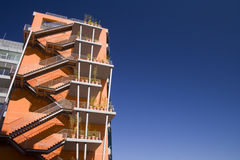 Orange Arquitecture. A modern building painted orange with a blue sky as copyspace Stock Photography