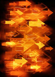 Orange arrows background. Orange fire color arrows moving on right background Royalty Free Stock Image