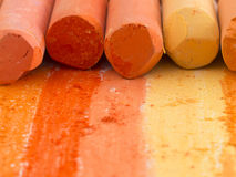 Orange artistic crayons Stock Images