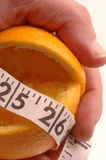 Orange as diet control Royalty Free Stock Images