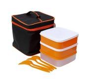 Orange askar med den svarta blixtlåspåsen Royaltyfri Fotografi