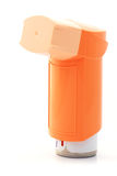 Orange asthma Inhaler. On white background Royalty Free Stock Photos
