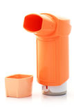 Orange asthma Inhaler and hood. On white background Royalty Free Stock Image