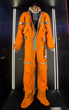 Orange astronaut suit. At exibition Cosmos Royalty Free Stock Photo