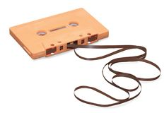 Orange audio cassette with magnetic tape isolated over w Royalty Free Stock Image