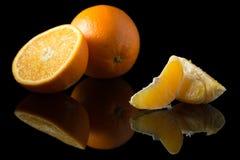 Orange auf Schwarzem Stockbild