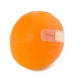 Orange Aufkleber hinzugefügtes Bluten auf Weiß Lizenzfreie Stockfotografie