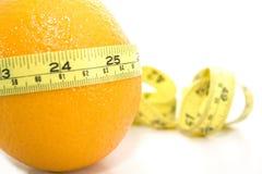 Orange avec le mètre jaune Image stock