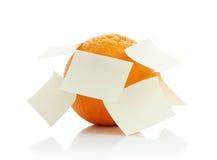 Orange avec une note photographie stock