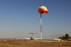 Orange aviation windsock blowing in the wind Royalty Free Stock Images