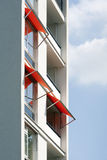 Orange awnings. On a white apartment block Royalty Free Stock Photography