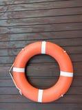 Orange bälte för livboj för säkerhet Fotografering för Bildbyråer