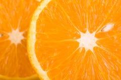 Orange background. Macro shot of two slices of an orange Stock Images