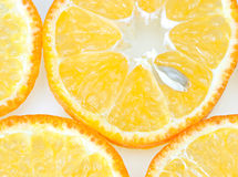 Orange background. Orange slices with stone on white background Stock Photography