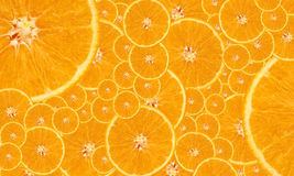 Orange background. Background of the pieces of bright ripe oranges Royalty Free Stock Photography