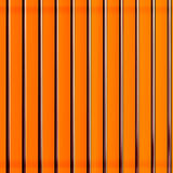 Orange background. Bright orange background with vertical lines royalty free stock photos