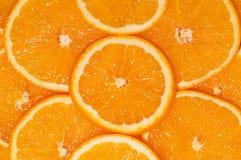 Orange background. Vibrant orange fruit slices wallpaper Stock Photos