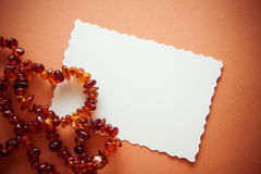 Orange background with amber beads for design Royalty Free Stock Photos