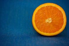 Orange, background. On a blue background orange, juicy, fresh, natural Royalty Free Stock Image