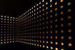 Orange background of circle light decorated wall Stock Image