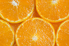 Orange background. Background close up slices of juicy ripe orange stock image
