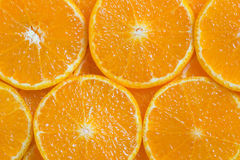 Orange background. Background close up slices of juicy ripe orange stock photos