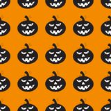 Halloween background with black pumpkins. Orange background design with black pumpkin pattern. Halloween theme clean design Royalty Free Stock Image