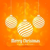 Orange background with hanging christmas balls in white color wi Stock Photo