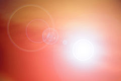 Orange background with lens flare Stock Photography