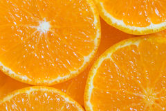 Orange background. Background macro slices of juicy ripe orange royalty free stock photos