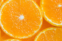 Orange background. Background macro slices of juicy ripe orange royalty free stock image