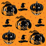 Orange background with pumpkins for Halloween. Silhouettes of pumkins Royalty Free Stock Photo
