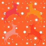 Orange deer pattern. Orange background with shapes of the deer and stars. The Abstract illustration with a variety red color of the deer shapes and seamless royalty free illustration