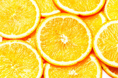 Orange Background. Slices of fresh orange fruit  closeup. Health Stock Photography