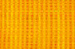 Orange background with small holes Stock Photo