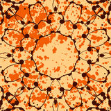 Orange background with splattered paint and Stock Images