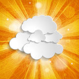 Orange background with sun rays and clouds Royalty Free Stock Image
