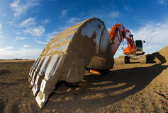 Orange backhoe Stock Images