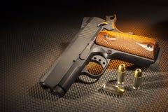 Orange backlit pistol and ammo Stock Photo