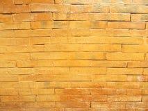 Orange Backsteinmauer lizenzfreie stockfotos