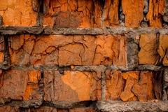 Orange Backsteinmauerhintergrund der gebrochenen konkreten Weinlese Lizenzfreie Stockfotografie