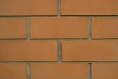 Orange Backsteinmauernahaufnahmehintergrund Lizenzfreies Stockbild